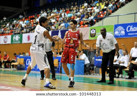 BANGKOK, THAILAND - APR 22: Unidentified players in action at Asean Basketball League 2012 (ABL) between Slammers vs San Miguel at Thai Japanese Association Gym on April 22, 2012 in Bangkok, Thailand