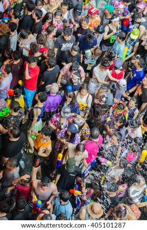 BANGKOK, THAILAND - April 13, 2016: A streetscape view of crowds of people celebrating Songkran Festival at Silom road