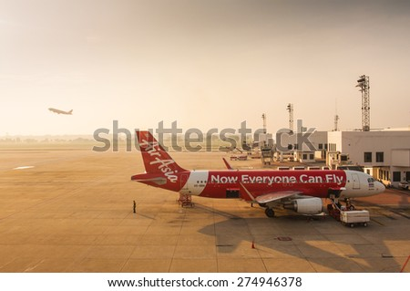 """BANGKOK,THAILAND-APRIL 28: """"Air Asia"""" a low cost Asian airlines is waiting for take off in Don Muang international airport on April 28, 2015 in Bangkok, Thailand. - stock photo"""