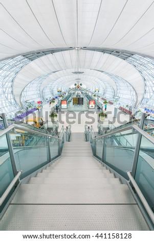 BANGKOK-THAILAND : 13 APRIL 2014 - Bangkok international Suvarnabhumi Airport with modern interior and architecture on 13 April 2014.handles 45 million passengers annually. - stock photo