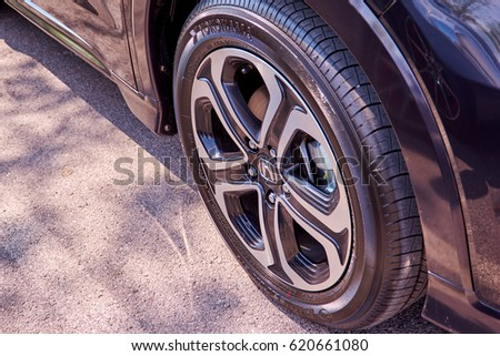 Bangkok, Thailand - April 13, 2017: Car wheel close up Honda HRV Black Steering Wheel And Silver Logo. Honda Motor Co., Ltd. is a Japanese public multinational conglomerate corporation.