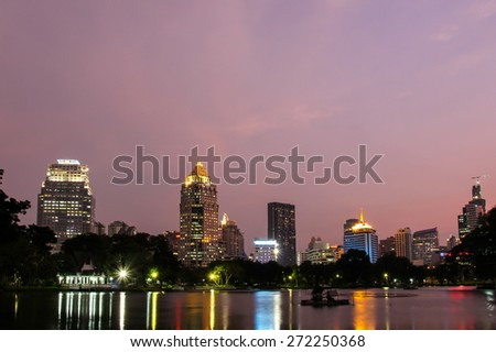 BANGKOK, THAILAND - APRIL 7,2015 : Cityscape from Lumpini Park in the business district on APRIL 7, 2015 in Bangkok, Thailand. Lumpini Park is the big park in center of Bangkok covers 142 acres. - stock photo