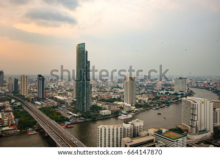 BANGKOK, THAILAND – APRIL 11, 2015 Cityscape of Bangkok city in the afternoon, Chao Phraya River, Taksin Bridge
