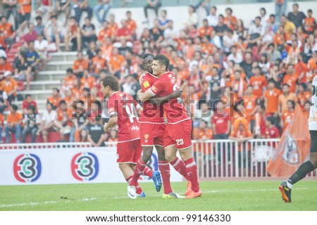 BANGKOK THAILAND - APRIL 1 : Cleiton Silva (R) in action during Thai Premier League (TPL) between BEC Tero (red) VS Chiangrai Utd (White) at Thebhussadin on April 1,2012 in Bangkok,Thailand.