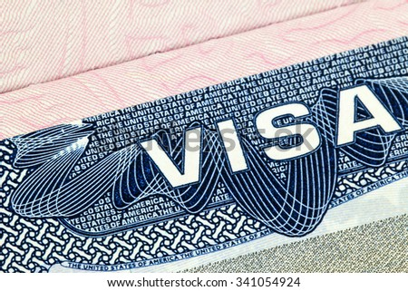 BANGKOK, THAILAND - APRIL 7, 2015 : Closeup of the Visa to The United States of America (USA) focusing on the word VISA in April 7, 2015 in Bangkok, Thailand - stock photo