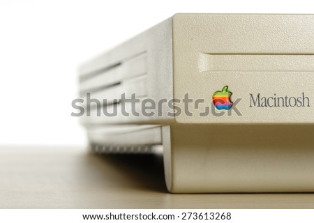 BANGKOK, THAILAND - APRIL 29, 2015: Closeup old rainbow Apple logo on old Macintosh computer.  - stock photo