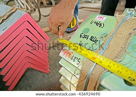 BANGKOK-THAILAND-APRIL 29 : Dimension Check steel structure for steel tower in Transmission line by Measuring Tape on April 29, 2016 Bangkok, Thailand