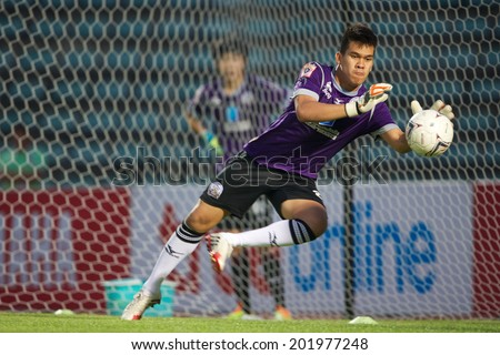 BANGKOK THAILAND-APRIL 05:Goalkeeper Wanlop Sae-Jiu of Police United  in for the ball during Thai Premier League Bangkok United and Police United at Thai-Japanese Stadiumon Apr 05,2014 in Thailand - stock photo