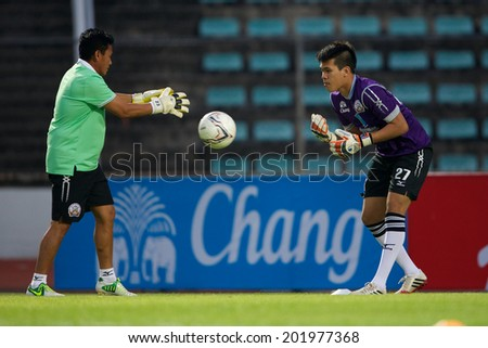 BANGKOK THAILAND-APRIL 05:Goalkeeper Wanlop Sae-Jiu #27 (R)of Police United  in action during Thai Premier League Bangkok United and Police United at Thai-Japanese Stadiumon Apr 05,2014 in Thailand - stock photo