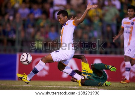 BANGKOK THAILAND-APRIL 21:Ngenevu Divine(R) of Suphanburi F.C.for the ball during Thai Premier League between Army United F.C.and Suphanburi F.C.at Thai Army Stadium on APRIL 21,2013in Thailand