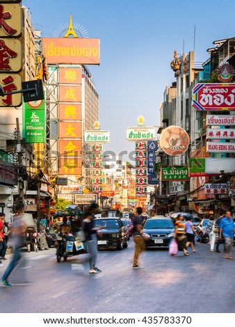 Bangkok, Thailand - April 24, 2016: People crossing busy Yaowarat road in Chinatown on April 24, 2016 in Bangkok, Thailand.