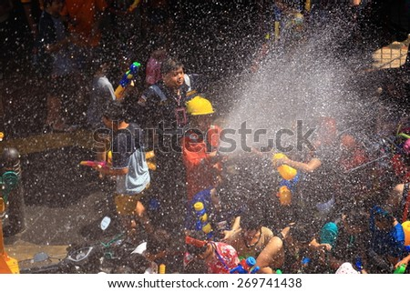 BANGKOK, THAILAND - APRIL 14, 2015: people playing water in Songkran festival on April 14, 2015 at Silom Road in Bangkok. Celebration of Thai New Year (Songkran water festival) in 2015.  - stock photo