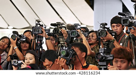 BANGKOK, THAILAND - APRIL19, 2011:Press and media on news conference. Filming an event with a video camera.