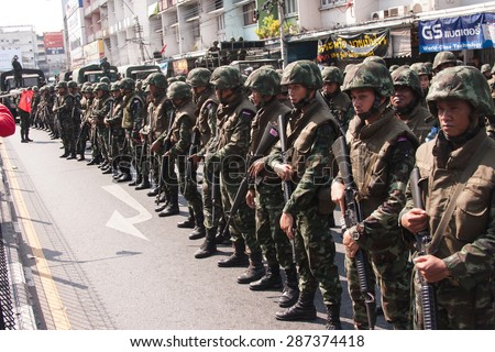 BANGKOK, THAILAND - APRIL 10, 2010: Riot army hold M16 rifles, the troop at Wisut kasat Road have 2 types, first one standard equipment riot control, second one uses m16 rifle reasoning self-protect.
