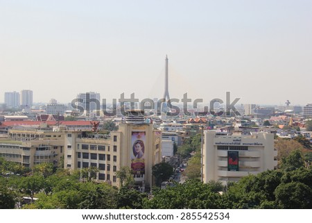 Bangkok, Thailand - April 21, 2015: Scenery of Ratchadamnoen Road, which is a historical road in Bangkok and Rama IX Bridge, which is the first cable-stay bridge in Thailand.
