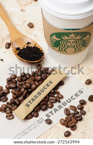 BANGKOK, THAILAND - APRIL 26, 2015: Starbucks sugar with roasted coffee beans. - stock photo