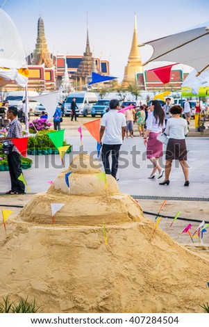 BANGKOK,THAILAND - APRIL 12, 2016 : Thai people come to build the Sand Pagoda for return the sand to the temple on Songran festival at Sanam luang (Phra kaew temple background) in Bangkok, Thailand - stock photo