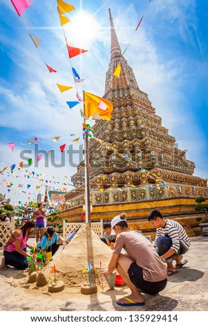 BANGKOK,THAILAND - APRIL 13: Thai people come to build the Sand Pagoda for return the sand to the temple on Songran festival at Pho temple on April 13,2013 in Bangkok,Thailand - stock photo