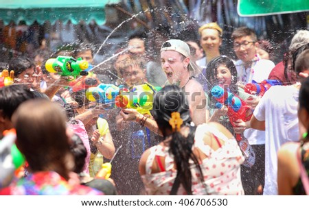 Bangkok, Thailand - April 13: Tourists shooting water guns and having fun at Songkran festival, the traditional Thai New Year, on Khao San Road in Bangkok, Thailand.