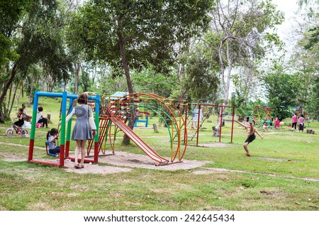 Bangkok, Thailand - April 24 , 2014 : Unidentified Children, adults in the amusement park  on April 24, 2014 in Bangkok, Thailand