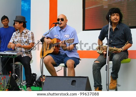BANGKOK, THAILAND-APRIL 7:Unidentified musician perform at Red Cross hall on the Bangkok on the street festival,On April 7, 2012 in Bangkok, Thailand. - stock photo