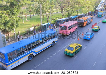 BANGKOK THAILAND - APRIL 19, 2015: Unidentified people catch buses at bus stop in Bangkok. Bangkok is famous for its heavy traffic congestion.  - stock photo