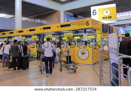 BANGKOK THAILAND - APRIL 23, 2015: Unidentified people check in for Nok Air flights at Don Mueang airport. Nok Air is a major low cost airline in Thailand founded in 2004.