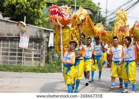 BANGKOK, THAILAND - April 4 2015: Unidentified people of parade Local tradition Thailand, Thai people playing chinese lion dance to celebrate of Songkran (Thai new year / water festival) - stock photo