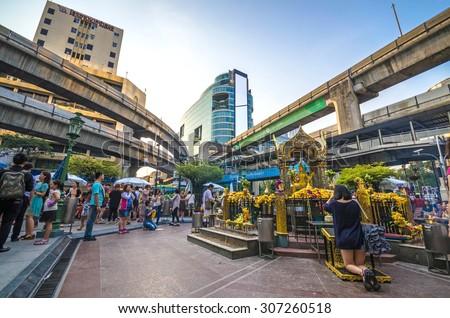 BANGKOK,THAILAND - 4 APRIL : Unidentified people pray respect the famous Erawan shrine at Ratchaprasong Junction on April 4, 2013 in Bangkok capital city,Thailand. - stock photo
