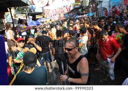 "BANGKOK, THAILAND - APRIL 13: Unidentified Thai and International people enjoy in ""Bangkok Songkran Festival 2012(Thailand new year)"" at Khao san Road on April 13,2012 in Bangkok, Thailand"