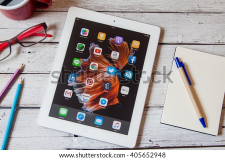 BANGKOK,THAILAND - Aprill 11,2016: Social media icons on screen of iPad and iPhone. Social media are most popular tool for communication, sharing information and content between people in internet. - stock photo