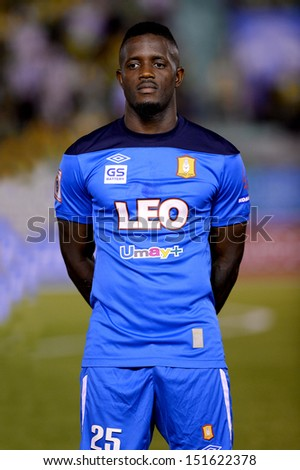 BANGKOK,THAILAND-AUG21:Lazarus Kaimbi of BGFC poses during Thai Premier League between Army United and Bangkok Glass FC at Army stadium on AUGUST21,2013 in Bangkok,Thailand.