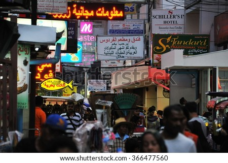 BANGKOK THAILAND - AUG 17, 2013: People walk through Soi Arab in the Sukhumvit Road Nana area. Soi Arab is a centre for Middle Eastern visitors and expats, with numerous Arabic restaurants and shops.