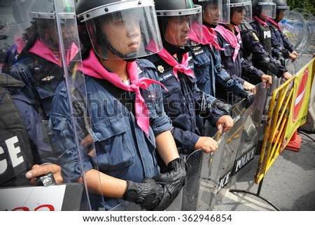 BANGKOK, THAILAND - AUG 7, 2013: Riot police stand guard near parliament during an anti government rally. Over 30,000 police are deployed at government sites amid protests surrounding an amnesty bill. - stock photo