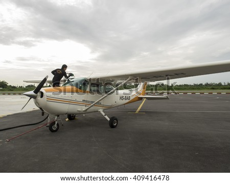 Bangkok, Thailand - Aug 5, 2014 : Small training aircraft on the airfield with sunset
