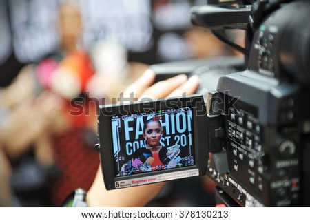 BANGKOK, THAILAND - AUG 7, 2012: View of a camera electronic viewfinder as a presenter gives an interview of a street fashion TV show.