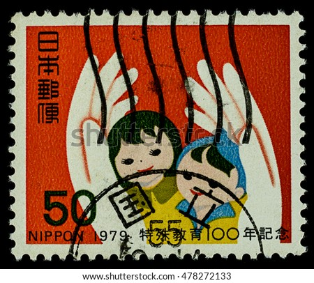 "BANGKOK, THAILAND - AUGUST 06, 2016: A postage stamp printed in Japan shows love hand and children, series ""centenary of education for handicapped"", circa 1979."