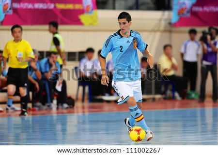 BANGKOK,THAILAND AUGUST24:Carlos Ortiz (blue) of Spain for the ball  during Friendly match between Thailand and Spain at Nimibutr Stadium on August24,2012 in Bangkok Thailand