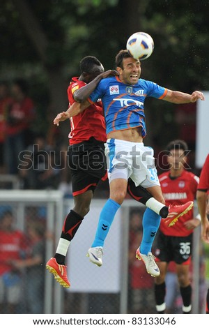 BANGKOK, THAILAND- AUGUST 20: Diego Costa Bastos Walsh (B)in action during Thai Premier League (TPL) between TOT SC and Muangthong United on August 20, 2011 at TOT Stadium in Bangkok, Thailand