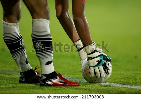 BANGKOK THAILAND-AUGUST16:Football player holding ball in during  the Thai Premier League between Muangthong UTD. and Samutsongkhram FC at SCG Stadium on Aug 16,2014 in Thailand. - stock photo