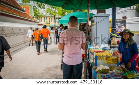 Bangkok - Thailand , August 25 - 2016 : Fruiterer sell thai style fruit on the side road at Wat Phra Chetupon Vimolmangklararm (Wat Pho) temple in Thailand.