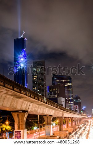 Bangkok,Thailand - August 29,2016 : Grand opening Mahanakorn Tower with light and sound show at bts sky train railway and sathorn RD.