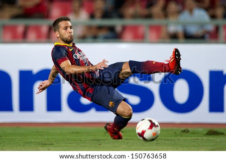 BANGKOK,THAILAND-AUGUST 07:Jordi Alba of FC Barcelona in action during the international friendly match Thailand XI and FC Barcelona at Rajamangala Stadium on August 7,2013 in,Thailand.