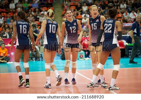BANGKOK,THAILAND-AUGUST15:Kelly Murphy #12 of USA with her team  celebrates  during the FIVB Women's World Grand Prix 2014  Brazil and USA at Indoor Stadium Huamark on Aug.15, 2014 in Thailand.
