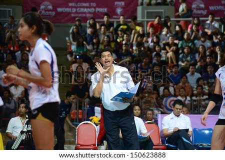 BANGKOK,THAILAND-AUGUST16,2013:Kiattipong Radchatagriengkai(R) head coach of Thailand team in action during FIVB Volleyball World Grand Prix 2013 at Indoor stadium on August16,2013 in Bangkok,Thailand