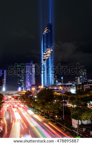 Bangkok,Thailand - August 29 , 2016 : Lighting show in Grand opening Mahanakhon tower in night time. New highest building landmark in Thailand and blur moving light of traffic of car