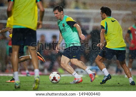 BANGKOK, THAILAND - AUGUST 06: Lionel Messi of Barcelona FC control the ball during Barcelona FC training session at Rajamangala Stadium on August 06, 2013 in Bangkok, Thailand.