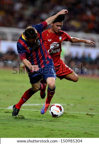 BANGKOK, THAILAND - AUGUST 7: Lionel Messi #10 of FC Barcelona in action during the international friendly match Thailand XI and FC Barcelona at Rajamangala Stadium on August7,2013 in,Thailand.   - stock photo