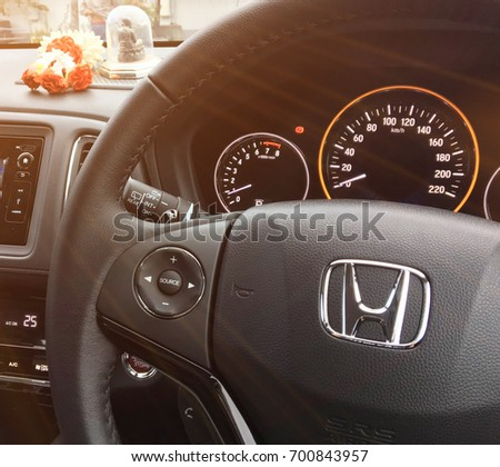 Bangkok, Thailand - August 19, 2017: Logo Honda on Black Steering Wheel and gauge, dashboard, instrument panel, speedometer. Honda is a Japanese multinational automotive manufacturing company.