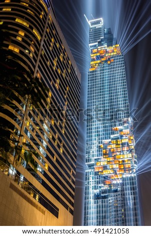 Bangkok, Thailand - August 29, 2016 : Mahanakorn Building light and laser show at its Grand Opening day, The building is the tallest building in Bangkok, Thailand at the moment.